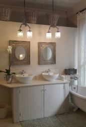 Fleur-de-Lis bathroom with shower and Victorian slipper bath
