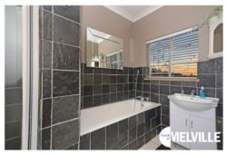 Bathroom, with tub and shower facilities - at 25 8th Avenue, Melville, Johannesburg.