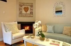 Cosy fire place for the cooler evenings, tastefully decorated with attention to detail and lots of love