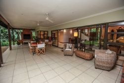 Large undercover veranda with braai & dining area near kitchen