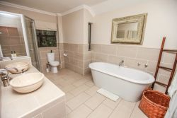 Main en-suite bathroom with free-standing bath