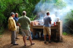 The communal braai under huge indigenous trees. Each cottage has private braai facilities.