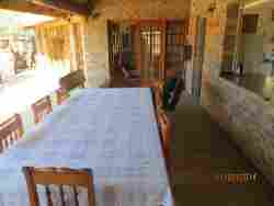 Kitchen table in front of kitchen, overlooking main lapa.