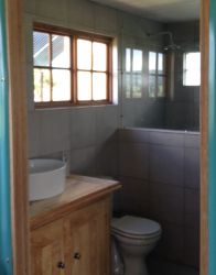 Bathroom with a large shower, and solar heated water