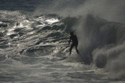 Enjoy watch�ing surfers carve into the Albatross surf spot's waves