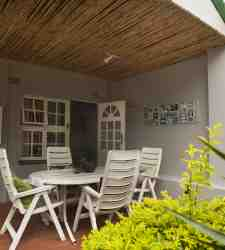 Covered verandah with outdoor furniture