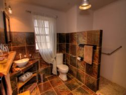 En-suite bathroom with walk-in shower - wheelchair friendly - Ferox Cottage No 2 and Striata Cottage no 4.
