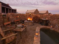 Boma, braai area and plunge pool at Karoo View Cottages