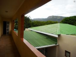 Upstairs rooms have a view of the mountain.