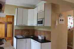 The modern, well-equipped kitchen is ideal for self-catering