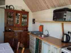 Kitchen counter tops, cupboards (enclosed bathroom behind)