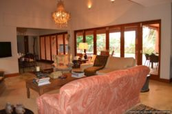 Lounge with large folding doors leading to the outside entertainment area