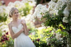 Bride in garden surrounded by roses