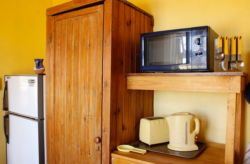 There's a fully equipped self-catering kitchen with tea and coffee, along with farm-fresh milk and homemade rusks.