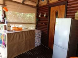 Outside deck area with mini kitchen, washing machine, fridge/freezer and much more