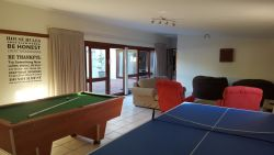 Games room with dart board, pool table and table tennis.