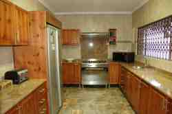Fully equipped kitchen with stove, microwave and fridge/freezer.