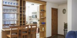 Open plan kitchen  and guest toilet, on lower level of duplex flat - Little Otter