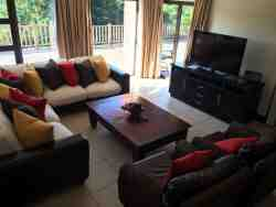 Large flat screen TV in lounge with full DSTV
