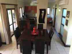 6 seater dining room table next to kitchen area