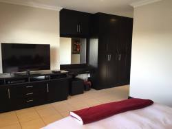 Large flat screen TV with DSTV in bedroom