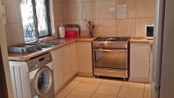 Birdsong fully equipped kitchen with microwave, kettle, toaster, fridge/freezer, washing machine, toasted sandwich maker, 5 burner gas oven and hob, iron/ ironing board