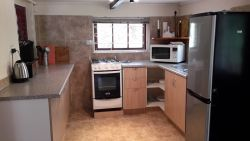 Haven fully equipped kitchen with gas oven and hob, microwave, kettle, toaster, fridge/freezer, toasted sandwich maker, iron/ironing board, crockery, cutlery, utensils, pots and pans etc
