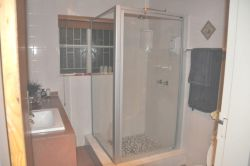 Main bathroom with large shower stall