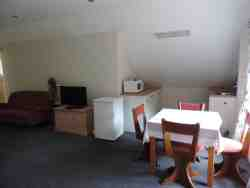 The extra large family room has a small kitchenette with microwave
