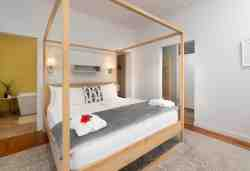 Romantic Suite - Garden room 1 with en-suite bath & shower as well as fireplace in the living area