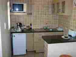 Compact kitchenettes in garden suites only