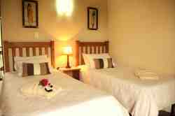 Room 3. Single beds with en-suite bathroom (shower only)