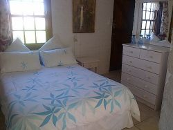 En Suite double bedded room with single bed.
