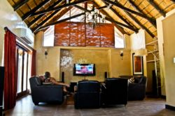 Main lodge lounge with DSTV and library