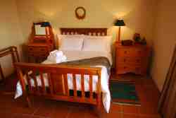 Room 2: Double bed with 3 single beds sharing.