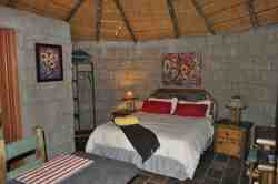 Our SunFlower cottage is ideal for a romantic getaway. Secluded and private in the bush against the mountain.