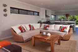 Lounge with bifolds to entertaining deck, and open plan to kitchen and dining