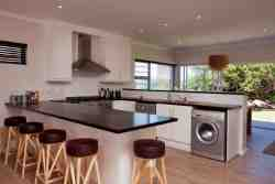 Fully equipped open plan kitchen with breakfast bar