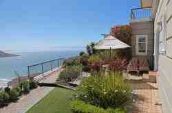 Dolphin Garden Suite Private garden area with vies over Fish Hoek Beach and False Bay