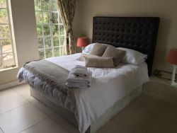 Apartment Queen Bedroom enjoys a full En Suite Bathroom with Shower and Bath, Luxurious Oversized Bathsheets