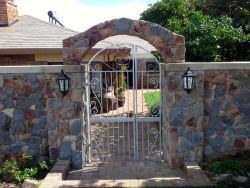 Ocean Song's stone wall entrance
