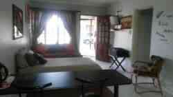 This is the kitchen, sitting area of the flat. with single bed that can also be changed to double bed.