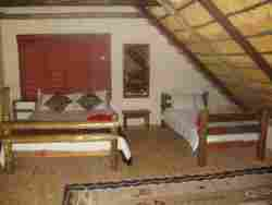 Loft: 1 Double bed and 2 Single beds.
