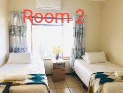 Room 2 ( 3 single beds ) R250 p/person/per nite.Total for 3 people R750.