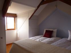 Lofft bedroom is light and airy with garden view