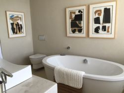 A Jack and Jill bathroom connects rooms two and three and has a free-standing bath, basin and toilet.