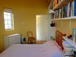 The Guest Bedroom has a double bed and a library of books to keep you entertained