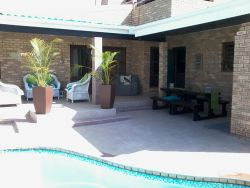 Unit B's outside braai area. The pool is for use by both Units.