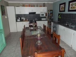 apartment has a huge fully equipped kitchen.