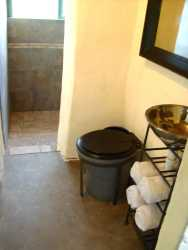 Bathroom with composting toilet, basin and large shower